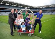 20 September 2011; Four year old Lucy O'Neill and five year old Conall Woods, from Clontarf, Dublin, with, from left, Uachtarán Chumann Lúthchleas Gael Criostóir Ó Cuana, Pat King, acting CEO, The Doyle Collection,  Padraic Joyce, Killererin, Galway, Michael Murphy, Glenswilly, Co. Donegal, Ryan O'Dwyer, Kilmacud Crokes, Dublin, and Ronan Curran, St Finbarr's, Cork, at the Croke Park Hotel and Croke Park Conference Centre GAA Club Support Programme launch. Croke Park, Dublin. Picture credit: Ray McManus / SPORTSFILE