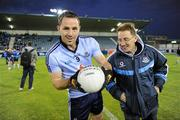 21 September 2011; Dublin's Declan Lally and trainer Niall Moyna with a 'Kerry' football before the game. Challenge game in aid of Crosscare and Temple Street Hospital, Dublin v Kilmacud Crokes, Parnell Park, Dublin. Picture credit: Ray McManus / SPORTSFILE