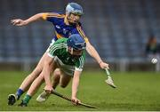 5 April 2017; Ciaran Barry of Limerick action against Jake Morris of Tipperary during the Electric Ireland Munster Minor Hurling Championship Quarter-Final match between Tipperary and Limerick at Semple Stadium in Thurles, Co. Tipperary. Photo by David Maher/Sportsfile