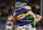 5 April 2017; Jake Morris of Tipperary action against Conor Flahive of Limerick during the Electric Ireland Munster Minor Hurling Championship Quarter-Final match between Tipperary and Limerick at Semple Stadium in Thurles, Co. Tipperary. Photo by David Maher/Sportsfile