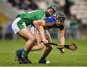 5 April 2017; Niall Hoctor of Tipperary action against Michael O'Grady of Limerick during the Electric Ireland Munster Minor Hurling Championship Quarter-Final match between Tipperary and Limerick at Semple Stadium in Thurles, Co. Tipperary. Photo by David Maher/Sportsfile