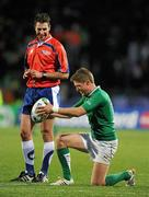 25 September 2011; Ireland out-half Ronan O'Gara shares a light-hearted moment with referee Craig Joubert as he prepares to convert a try by Rob Kearney. The kick was successful and made O'Gara Ireland's leading points scorer in Rugby World Cup matches with 72 points ahead of David Humphreys, who previously held the highest total with 70 points. 2011 Rugby World Cup, Pool C, Ireland v Russia, Rotorua International Stadium, Rotorua, New Zealand. Picture credit: Brendan Moran / SPORTSFILE