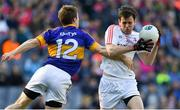 8 April 2017; Pauric Smith of Louth is tackled by Brian Fox of Tipperary during the Allianz Football League Division 3 Final match between Louth and Tipperary at Croke Park in Dublin. Photo by Brendan Moran/Sportsfile