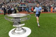 18 September 2011; Diarmuid Connolly, Dublin, runs out on to the pitch past the Sam Maguire cup. GAA Football All-Ireland Senior Championship Final, Kerry v Dublin, Croke Park, Dublin. Picture credit: Paul Mohan / SPORTSFILE
