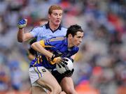 18 September 2011; Dylan Fitzelle, Tipperary, is tackled by Ciaran Kilkenny, Dublin. GAA Football All-Ireland Minor Championship Final, Tipperary v Dublin, Croke Park, Dublin. Picture credit: Stephen McCarthy / SPORTSFILE