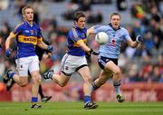 18 September 2011; Liam McGrath, Tipperary, with support from John McGrath, left, in action against John Small, Dublin. GAA Football All-Ireland Minor Championship Final, Tipperary v Dublin, Croke Park, Dublin. Picture credit: Stephen McCarthy / SPORTSFILE