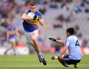 18 September 2011; Michael Quinlivan, Tipperary, in action against Rutherson Real, Dublin. GAA Football All-Ireland Minor Championship Final, Tipperary v Dublin, Croke Park, Dublin. Picture credit: Stephen McCarthy / SPORTSFILE