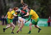 9 April 2017; Grace Kelly of Mayo in action against Deirdre Foley, left, and Emer Gallagher of Donegal during the Lidl Ladies Football National League Division 1 Refixture match between Donegal and Mayo at St Mary's GAA Club, in Convoy, Co. Donegal. Photo by Sam Barnes/Sportsfile
