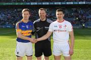 8 April 2017; Tipperary captain Brian Fox and Louth captain Adrian Reid shake hands accross referee Anthony Nolan before the Allianz Football League Division 3 Final match between Louth and Tipperary at Croke Park in Dublin. Photo by Ray McManus/Sportsfile