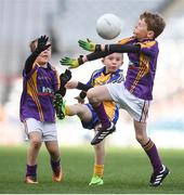 11 April 2017; Conor Maguire, representing St Mochtas GAA Club, Co. Louth, in action against Daniel Curley, left, and Cormac McKenna, representing Wolftones GAA Club, Co. Meath, during the The Go Games Provincial Days in partnership with Littlewoods Ireland Day 2 at Croke Park in Dublin. Photo by Cody Glenn/Sportsfile