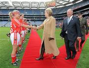 25 September 2011; Cork captain Amy O'Shea shakes hands with President of Ireland Mary McAleese in the presence of Pat Quill, Uachtaran Cumann Peil Gael na mBan. TG4 All-Ireland Ladies Senior Football Championship Final, Cork v Monaghan, Croke Park, Dublin. Picture credit: Pat Murphy / SPORTSFILE