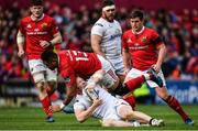 15 April 2017; Stuart Olding of Ulster is tackled by Francis Saili of Munster during the Guinness PRO12 match between Munster and Ulster at Thomond Park in Limerick. Photo by Ramsey Cardy/Sportsfile