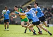 15 April 2017; Stephen McBrearty of Donegal in action against, from left, Andrew McGowan, Aaron Elliot and Darren Gavin of Dublin during the EirGrid GAA Football All-Ireland U21 Championship Semi-Final match between Dublin and Donegal at Kingspan Breffni Park in Cavan. Photo by Cody Glenn/Sportsfile