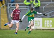 15 April 2017; Ordan Kiely of Kerry scores a goal despite the challenge of Liam Kelly of Galway during the EirGrid GAA Football All-Ireland U21 Championship Semi-Final match between Galway and Kerry at Cusack Park in Ennis, Co Clare. Photo by Ray Ryan/Sportsfile