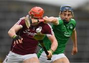 16 April 2017; The sliothar is the centre of focus as Conor Whelan of Galway is tackled by Mike Casey of Limerick during the Allianz Hurling League Division 1 Semi-Final match between Limerick and Galway at the Gaelic Grounds in Limerick. Photo by Ray McManus/Sportsfile
