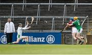 16 April 2017; Conor Cooney of Galway scores his side's first goal despite the efforts of Limerick's Richie English and goalkeeper Nickie Quaid during the Allianz Hurling League Division 1 Semi-Final match between Limerick and Galway at the Gaelic Grounds in Limerick. Photo by Diarmuid Greene/Sportsfile