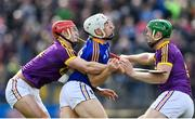 16 April 2017; Niall O'Meara of Tipperary is tackled by Lee Chin, left, and Matthew O'Hanlon of Wexford during the Allianz Hurling League Division 1 Semi-Final match between Wexford and Tipperary at Nowlan Park in Kilkenny. Photo by Ramsey Cardy/Sportsfile