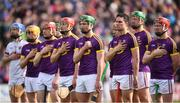 16 April 2017; Wexford players during the National Anthem prior to the Allianz Hurling League Division 1 Semi-Final match between Wexford and Tipperary at Nowlan Park in Kilkenny. Photo by Stephen McCarthy/Sportsfile