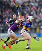 16 April 2017; Niall O'Meara of Tipperary is tackled by Lee Chin of Wexford during the Allianz Hurling League Division 1 Semi-Final match between Wexford and Tipperary at Nowlan Park in Kilkenny. Photo by Ramsey Cardy/Sportsfile