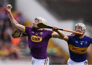 16 April 2017; David Dunne of Wexford in action against Michael Cahill of Tipperary during the Allianz Hurling League Division 1 Semi-Final match between Wexford and Tipperary at Nowlan Park in Kilkenny. Photo by Stephen McCarthy/Sportsfile