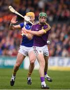 16 April 2017; Aidan Nolan of Wexford in action against PadraicMaher of Tipperary during the Allianz Hurling League Division 1 Semi-Final match between Wexford and Tipperary at Nowlan Park in Kilkenny. Photo by Stephen McCarthy/Sportsfile