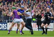 16 April 2017; Wexford manager Davy Fitzgerald tussles with Jason Forde of Tipperary during the Allianz Hurling League Division 1 Semi-Final match between Wexford and Tipperary at Nowlan Park in Kilkenny. Photo by Ramsey Cardy/Sportsfile