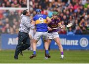 16 April 2017; Wexford manager Davy Fitzgerald with Jason Forde of Tipperary and Aidan Nolan of Wexford during the Allianz Hurling League Division 1 Semi-Final match between Wexford and Tipperary at Nowlan Park in Kilkenny. Photo by Stephen McCarthy/Sportsfile