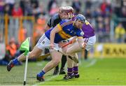 16 April 2017; Jason Forde of Tipperary is tackled by James Breen of Wexford during the Allianz Hurling League Division 1 Semi-Final match between Wexford and Tipperary at Nowlan Park in Kilkenny. Photo by Ramsey Cardy/Sportsfile