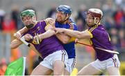 16 April 2017; Jason Forde of Tipperary is tackled by Aidan Nolan, left, and James Breen of Wexford during the Allianz Hurling League Division 1 Semi-Final match between Wexford and Tipperary at Nowlan Park in Kilkenny. Photo by Ramsey Cardy/Sportsfile