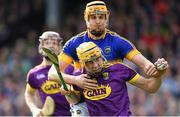 16 April 2017; Damien Reck of Wexford is tackled by Seamus Callanan of Tipperary during the Allianz Hurling League Division 1 Semi-Final match between Wexford and Tipperary at Nowlan Park in Kilkenny. Photo by Ramsey Cardy/Sportsfile