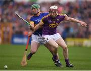 16 April 2017; John O'Dwyer of Tipperary in action against James Breen of Wexford during the Allianz Hurling League Division 1 Semi-Final match between Wexford and Tipperary at Nowlan Park in Kilkenny. Photo by Stephen McCarthy/Sportsfile