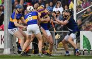 16 April 2017; Jack Guiney of Wexford is tackled by Tipperary players, from left, Tomás Hamill, Ronan Maher, PadraicMaher and Darren Gleeson during the Allianz Hurling League Division 1 Semi-Final match between Wexford and Tipperary at Nowlan Park in Kilkenny. Photo by Ramsey Cardy/Sportsfile
