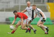 9 October 2011; Derek Kelly, Edenderry, in action against Peter Flanagan, right, and Scott Brady, Clara. Tullamore Court Hotel Senior Football Final, Clara v Edenderry, O'Connor Park, Tullamore, Co. Offaly. Picture credit: Diarmuid Greene / SPORTSFILE