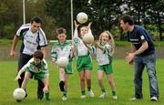 12 October 2011; Pictured at St Josephs GAA Club Ederney, in Fermanagh, were Sean Og O hAilpin, Ulster Bank GAA Force Ambassador, and Sean Donnelly, Club Sectretary, St Josephs GAA Club Ederney, along with Eoghan Donnelly, John McElhill, Eirin McMenamin and Katie Teague, club members and pupils of St Josephs PS Ederney. St Josephs GAA Club Ederney, in Fermanagh received a major boost as Ulster Bank announced them as winners of 'Ulster Bank GAA Force' – a major club focused initiative supporting local GAA clubs by giving them the opportunity to refurbish and upgrade their facilities. Ulster Bank GAA Force was introduced this summer to coincide with Ulster Bank's sponsorship of the GAA Football All-Ireland Championships. St Josephs GAA Club was awarded a support package worth €22,000. Four runners up were also awarded support packages worth €5,000. St. Joseph's GAA Club, Drumkeen, Ederney, Co. Fermanagh. Picture credit: Oliver McVeigh / SPORTSFILE