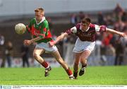 19 May 2002; Stephen Hughes, Mayo, in action against Padraig Moran, Galway. Mayo v Galway, Connacht Minor Football Championship, Dr Hyde Park, Co. Roscommon. Picture credit; Brian Lawless / SPORTSFILE