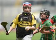 19 April 2017; Caithlyn Treacy representing Clonakenny, Co. Tipperary, in action against Bryan Quilter representing Crotta O'Neills, Co. Kerry, during the Go Games Provincial Days in partnership with Littlewoods Ireland Day 5 at Croke Park in Dublin. Photo by Matt Browne/Sportsfile