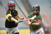 19 April 2017; Bryan Quilter representing Crotta O'Neills, Co. Kerry, in action against Caithlyn Treacy representing Clonakenny, Co. Tipperary, during the Go Games Provincial Days in partnership with Littlewoods Ireland Day 5 at Croke Park in Dublin. Photo by Matt Browne/Sportsfile