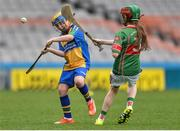 19 April 2017; Josh Flynn, representing Sacred Heart, Co. Waterford, in action against Niamh Quinn, representing Crotta O'Neills, Co. Kerry, during the Go Games Provincial Days in partnership with Littlewoods Ireland Day 5 at Croke Park in Dublin.   Photo by Piaras Ó Mídheach/Sportsfile