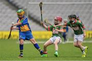 19 April 2017; Jim Kelly, representing Sacred Heart, Co. Waterford, in action against Darragh Nolan, centre, and Jack Ryan, representing Crotta O'Neills, Co. Kerry, during the Go Games Provincial Days in partnership with Littlewoods Ireland Day 5 at Croke Park in Dublin.   Photo by Piaras Ó Mídheach/Sportsfile