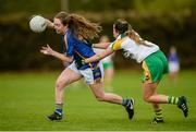 16 April 2017; Caoimhe Condon of Tipperary in action against Ellee McEvoy of Offaly during the Lidl Ladies Football National League Division 3 Semi-Final match between Tipperary and Offaly at Clane GAA Club in Clane, Co Kildare. Photo by Piaras Ó Mídheach/Sportsfile