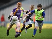 21 April 2017; Niall McKenna, representing Derrygonnelly Harps GAA Club, Co Fermanagh, in action against Aaron Dohert, representing Devenish St Mary's GAA Club, Co Fermanagh, during the Go Games Provincial Days in partnership with Littlewoods Ireland Day 7 at Croke Park in Dublin. Photo by Cody Glenn/Sportsfile
