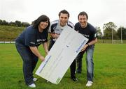12 October 2011; Pictured at St Josephs GAA Club Ederney, in Fermanagh, were Dearbhaile McHugh, Sean Donnelly, Club Treasurer, St Josephs GAA Club Ederney, Sean Og O hAilpin, Ulster Bank GAA Force Ambassador. St Josephs GAA Club Ederney, in Fermanagh, received a major boost as Ulster Bank announced them as winners of 'Ulster Bank GAA Force' – a major club focused initiative supporting local GAA clubs by giving them the opportunity to refurbish and upgrade their facilities. Ulster Bank GAA Force was introduced this summer to coincide with Ulster Bank's sponsorship of the GAA Football All-Ireland Championships. St Josephs GAA Club was awarded a support package worth €22,000. Four runners up were also awarded support packages worth €5,000. St. Joseph's GAA Club, Drumkeen, Ederney, Co. Fermanagh. Picture credit: Oliver McVeigh / SPORTSFILE