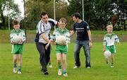12 October 2011; Pictured at St Josephs GAA Club Ederney, in Fermanagh, were, Sean Og O hAilpin, Ulster Bank GAA Force Ambassador, and Sean Donnelly, Club Sectretary St Josephs GAA Club Ederney, with John McElhill, Daragh McGee and Shauna McElhill, club members and pupils of St Josephs PS Ederney. St Josephs GAA Club Ederney, in Fermanagh, received a major boost as Ulster Bank announced them as winners of 'Ulster Bank GAA Force' – a major club focused initiative supporting local GAA clubs by giving them the opportunity to refurbish and upgrade their facilities. Ulster Bank GAA Force was introduced this summer to coincide with Ulster Bank's sponsorship of the GAA Football All-Ireland Championships. St Josephs GAA Club was awarded a support package worth €22,000. Four runners up were also awarded support packages worth €5,000. St. Joseph's GAA Club, Drumkeen, Ederney, Co. Fermanagh. Picture credit: Oliver McVeigh / SPORTSFILE