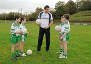 12 October 2011; Pictured at St Josephs GAA Club Ederney, in Fermanagh, were Sean Og O hAilpin, Ulster Bank GAA Force Ambassador, with Eoghan Donnelly, Eirin McMenamin, John McElhill and Darragh McGee, club members and pupils of St Josephs PS Ederney. St Josephs GAA Club Ederney, in Fermanagh, received a major boost as Ulster Bank announced them as winners of 'Ulster Bank GAA Force' – a major club focused initiative supporting local GAA clubs by giving them the opportunity to refurbish and upgrade their facilities. Ulster Bank GAA Force was introduced this summer to coincide with Ulster Bank's sponsorship of the GAA Football All-Ireland Championships. St Josephs GAA Club was awarded a support package worth €22,000. Four runners up were also awarded support packages worth €5,000. St. Joseph's GAA Club, Drumkeen, Ederney, Co. Fermanagh. Picture credit: Oliver McVeigh / SPORTSFILE