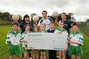 12 October 2011; Pictured at St Josephs GAA Club Ederney, in Fermanagh, were Dearbhaile McHugh, club tresurer St Josephs GAA Club Ederney, Sean Og O hAilpin, Ulster Bank GAA Force Ambassador, and Sean Donnelly, Club Sectretary St Josephs GAA Club Ederney, with Eoghan Donnelly, Eirin McMenamin, Katie Teague, Shauna McElhill, Sean Cassidy, Darragh McGee and John McElhill, club players and pupils of St Joseph's PS Ederney. St Josephs GAA Club Ederney, in Fermanagh, received a major boost as Ulster Bank announced them as winners of 'Ulster Bank GAA Force' – a major club focused initiative supporting local GAA clubs by giving them the opportunity to refurbish and upgrade their facilities. Ulster Bank GAA Force was introduced this summer to coincide with Ulster Bank's sponsorship of the GAA Football All-Ireland Championships. St Josephs GAA Club was awarded a support package worth €22,000. Four runners up were also awarded support packages worth €5,000. St. Joseph's GAA Club, Drumkeen, Ederney, Co. Fermanagh. Picture credit: Oliver McVeigh / SPORTSFILE