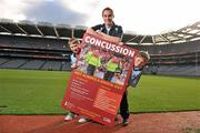 19 October 2011; The GAA has teamed up with brain injury specialists Acquired Brain Injury Ireland to back their Mind Your Head campaign; educating players about the signs and symptoms of Concussion, through an Educational Concussion Poster Campaign. This poster campaign will be distributed to over 1800 GAA clubs throughout the country, reaching out to all players of every age and level. Present at the launch were Dublin Footballer and ABI Ireland Ambassadors Michael Darragh Macauley, with Sean O'Connell, left, age 9 from Stepaside, Co. Dublin and Mark Bailey, age 8 from Killiney, Co. Dublin. GAA and ABI Ireland Launch Concussion Awareness Campaign, Croke Park, Dublin. Picture credit: David Maher / SPORTSFILE