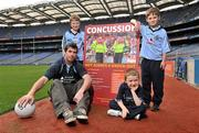 19 October 2011; The GAA has teamed up with brain injury specialists Acquired Brain Injury Ireland to back their Mind Your Head campaign; educating players about the signs and symptoms of Concussion, through an Educational Concussion Poster Campaign. This poster campaign will be distributed to over 1800 GAA clubs throughout the country, reaching out to all players of every age and level. Present at the launch were Dublin Footballer and ABI Ireland Ambassadors Michael Darragh Macauley, with children, left to right, Sean O'Connell, age 9, from Stepaside, Co. Dublin, his brother James O'Connell, age 5, and Mark Bailey, age 8, from Killiney, Co. Dublin. GAA and ABI Ireland Launch Concussion Awareness Campaign, Croke Park, Dublin. Picture credit: David Maher / SPORTSFILE