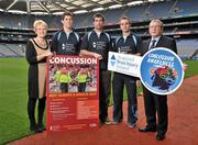 19 October 2011; The GAA has teamed up with brain injury specialists Acquired Brain Injury Ireland to back their Mind Your Head campaign; educating players about the signs and symptoms of Concussion, through an Educational Concussion Poster Campaign. This poster campaign will be distributed to over 1800 GAA clubs throughout the country, reaching out to all players of every age and level. Present at the launch are ABI Ireland CEO Barbara O' Connell, with, from left to right, Dublin football players and ABI Ireland Ambassadors Michael Darragh Macauley, Rory O'Carroll, Dr. Danny Mulvihill, Chairman of the GAA Medical Committee, and Dublin footballer Paul Griffin. GAA and ABI Ireland Launch Concussion Awareness Campaign, Croke Park, Dublin. Picture credit: David Maher / SPORTSFILE