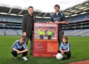 19 October 2011; The GAA has teamed up with brain injury specialists Acquired Brain Injury Ireland to back their Mind Your Head campaign; educating players about the signs and symptoms of Concussion, through an Educational Concussion Poster Campaign. This poster campaign will be distributed to over 1800 GAA clubs throughout the country, reaching out to all players of every age and level. Present at the launch were GPA CEO Dessie Farrell, with Dublin footballer and ABI Ireland ambassador Michael Darragh Macauley, with Sean O'Connell, left, age 9, from Stepaside, Co. Dublin, and Mark Bailey, age 8, from Killiney, Co. Dublin. GAA and ABI Ireland Launch Concussion Awareness Campaign, Croke Park, Dublin. Picture credit: David Maher / SPORTSFILE