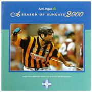 This 133 page hardback coffee table book (300mm x 300mm) is a collection of images of the 2000 Gaelic Games year by the Sportsfile photographers.                With text by Irish Times journalist, Tom Humphries, it is a treasured record of the 2000 GAA season to be savoured by players, spectators and enthusiasts everywhere.                 A Season of Sundays 2000 is a stocktaking. A look back at the images of the Gaelic games year, winners, losers, good times and bad and some of the flavour that lies between. These pictures are a frozen moment of a people's obsession.